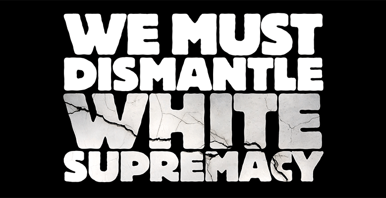 "Banner reading ""We must dismantle white supremacy"""